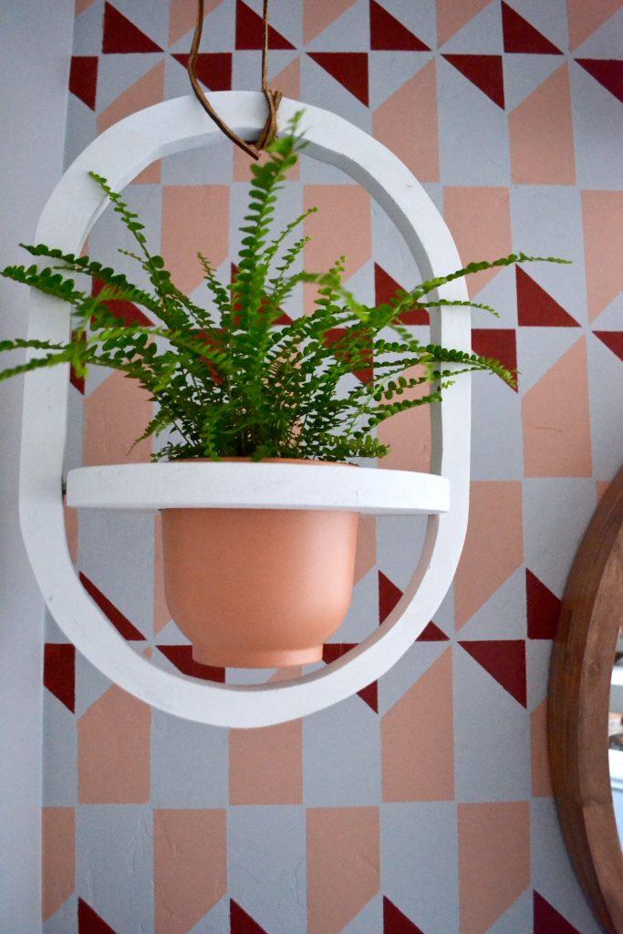 eclectic master bathroom, vintage rug, stenciled floors, diy bathroom, thrifted hanging planter