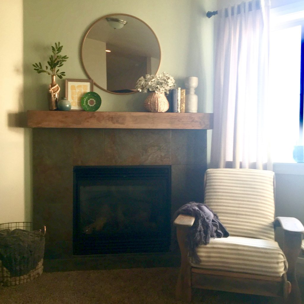 original stone fireplace with styled mantel